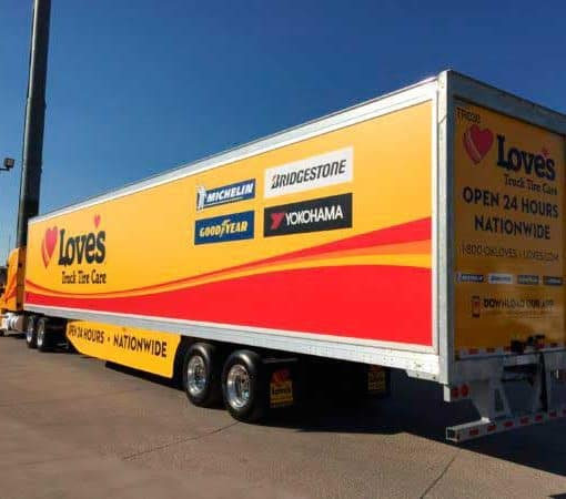 Trackside advertising on semi trailer with media frame and banner