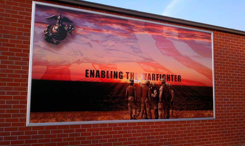 banner media frame on brick wall