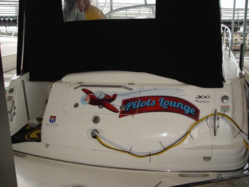 Boat name design with printed, laminated and contour cut vinyl logo